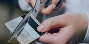 Image of someone cutting up credit card - Debt Recovery Solicitors BTTJ