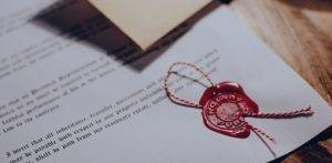 Image of wax stamp on paper - Notarial Services from BTTJ